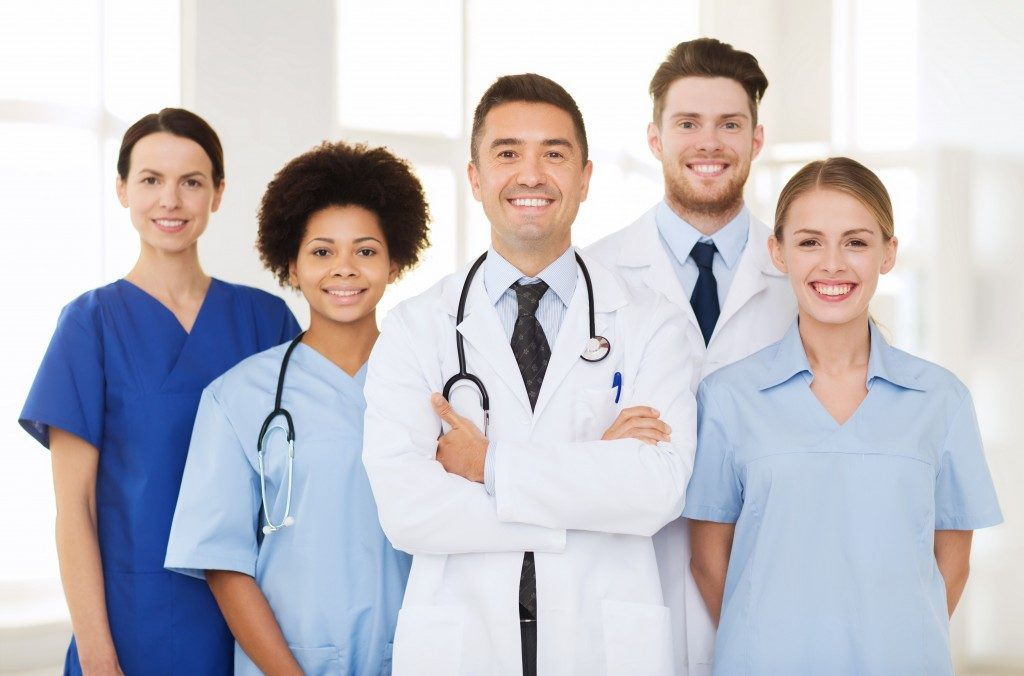 team of smiling doctors