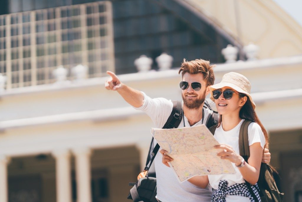 couple navigating map during vacation